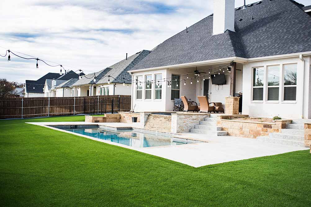 Synthetic Grass around a pool at a Fort Worth home